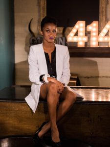 Woman in long white blazer and black pumps. Styled by Khalilah Jones of Chic and Classy Image Consulting
