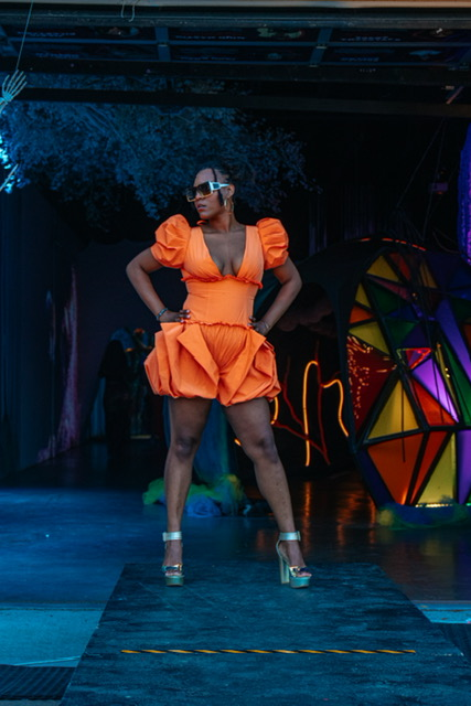 Soul of Cville, fashion show highlights woman in orange
